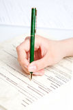 Complete a form. Macro shot of complete a form Royalty Free Stock Photo