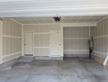 Complete garage of a wooden house Stock Image