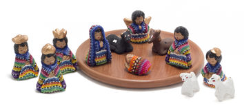 Complete guatemalan nativity scene. Traditional colorful handmade christmas figures made of fabric and clay with wise man, shepherd's and sheep stock photos