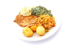 Complete healthy meal. Plate of a complete healthy meal with roasted meat, potatoes, rice and various vegetables in creamy sauce. Image isolated on white studio royalty free stock images