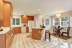 Complete kitchen with tile floor. Royalty Free Stock Image