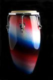 Complete Latin Conga Drum. A silver, red, and blue Latin or African conga  drum isolated against a  black background with copy space Stock Images
