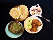 Complete menu (soup, mashed potato and fillet,dessert and pomelo fruit) Stock Images