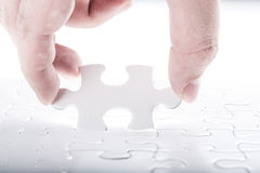 Complete missing jigsaw puzzle Stock Photos
