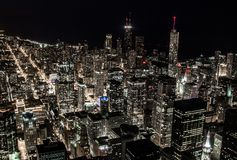 The beauty of lights in the big city. Complete night darkness in the downtown of a big city with towers and skyscrapers, all lights are on and making the night Royalty Free Stock Photo