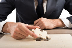 Complete a puzzle Stock Photo