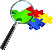 Complete Puzzle under Magnifying Glass Stock Images