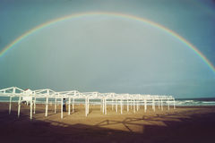 Complete rainbow in the beach. Rainbow over a beach of Mar del Plata, Argentina Royalty Free Stock Images