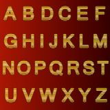 A complete set of gold  3D letters cut into straight strips. The edges of the letters are rounded. Font is isolated by a dark red. Background.  Vector Stock Images