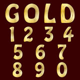 A complete set of numbers with gold striped surface. Font is isolated by a velvety dark crimson background. Royalty Free Stock Photo