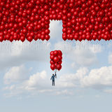 Complete Solution. Business concept as a businessman with a group of balloons as a missing part of a larger organization as a concept for integration and a Stock Images