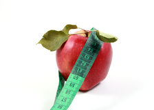 Complete with white background red apple tape measure Stock Photo