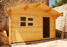 Almost Complete Wooden Cabin With Window Royalty Free Stock Photography