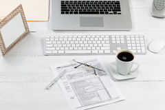 Complete working desktop with tax forms Royalty Free Stock Photography