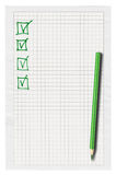 Completed checklist. Piece of squared paper with completed checklist over white background Royalty Free Stock Photos