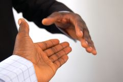 Completed Deal. This is an image of a two hands about to perform a handshake Stock Image