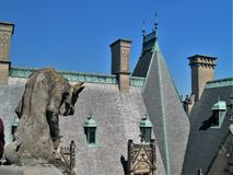 Biltmore House. Completed in 1895, a gargoyle guards the roof of this American castle found in Asheville, North Carolina stock image