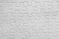 Completed jigsaw puzzle. Unity:blank grey jigsaw puzzle pieces all connected, great details of textured cardboard material Stock Photo