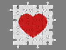 Completed mosaic from puzzles with symbol of heart. There is a clipping path Stock Photography