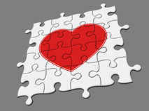 Completed mosaic from puzzles with symbol of heart. There is a clipping path Royalty Free Stock Photos
