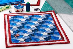 Completed quilt with stylized elements of American flag, patchwo Royalty Free Stock Photos