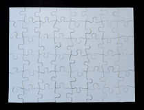 Completed White Jigsaw Puzzle on Black Background Stock Photography
