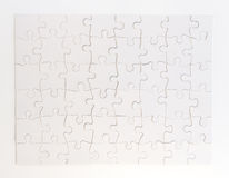 Completed White Jigsaw Puzzle Stock Photo