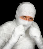 Completely bandaged man is ready to fight royalty free stock images