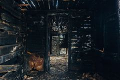 Completely burnt wooden house. Consequences of fire.  royalty free stock photos