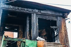Completely burnt wooden house. Consequences of fire.  stock images
