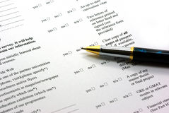 Completing application form. In education Royalty Free Stock Images