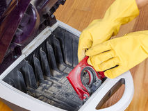 Completing Cleanup of Vacuum Cleaner Royalty Free Stock Image