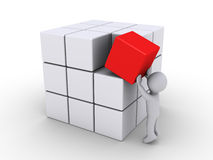 Completing the cubes. 3d person putting red cube with other white ones Royalty Free Stock Images