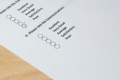 Completing customer survey form Stock Image