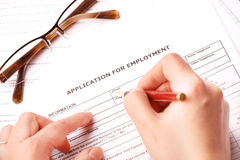 Completing an employment application Stock Photos