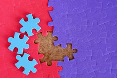 Completing the missing jigsaw. Puzzle concept Royalty Free Stock Image