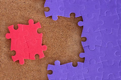 Completing the missing jigsaw. Puzzle concept Stock Image