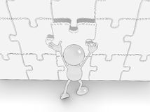 Completing the puzzle Royalty Free Stock Photos