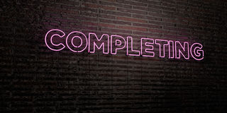 COMPLETING -Realistic Neon Sign on Brick Wall background - 3D rendered royalty free stock image Royalty Free Stock Photo
