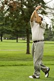 Completing Swing. Not posed - actual action shot of a excellent golfer comleting his swing. More in portfolio royalty free stock image