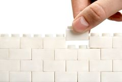 Completing the wall. Isolated over white Royalty Free Stock Image