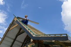 Completing work on a roof Stock Image