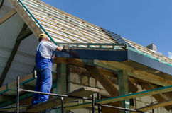Completing work on a roof Royalty Free Stock Image