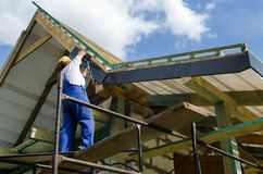 Completing work on a roof Stock Photo