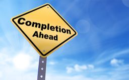 Completion ahead sign. On blue sky background,3d rendered Stock Photo