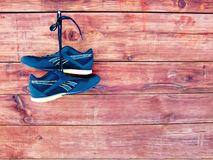 Completion of the career. Completion of the athletic career, shoes hanging on a nail royalty free stock photos