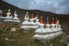 Complex of 108 Buddhist ritual structures Stupas on the hillside of Sacred Mount Kailash. Royalty Free Stock Photography