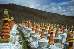 Complex of 108 Buddhist ritual structures Stupas on the hillside of Sacred Mount Kailash. Royalty Free Stock Photo