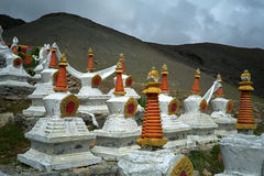 Complex of 108 Buddhist ritual structures Stupas on the hillside of Sacred Mount Kailash. Stock Photos