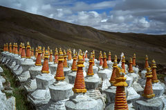 Complex of 108 Buddhist ritual structures Stupas on the hillside of Sacred Mount Kailash. Royalty Free Stock Images